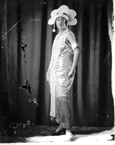 Full length female portrait, unusual costume and headpiece